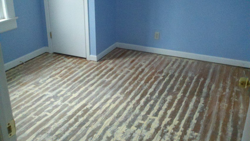 a scratched and damaged hardwood floor in the san antonio area