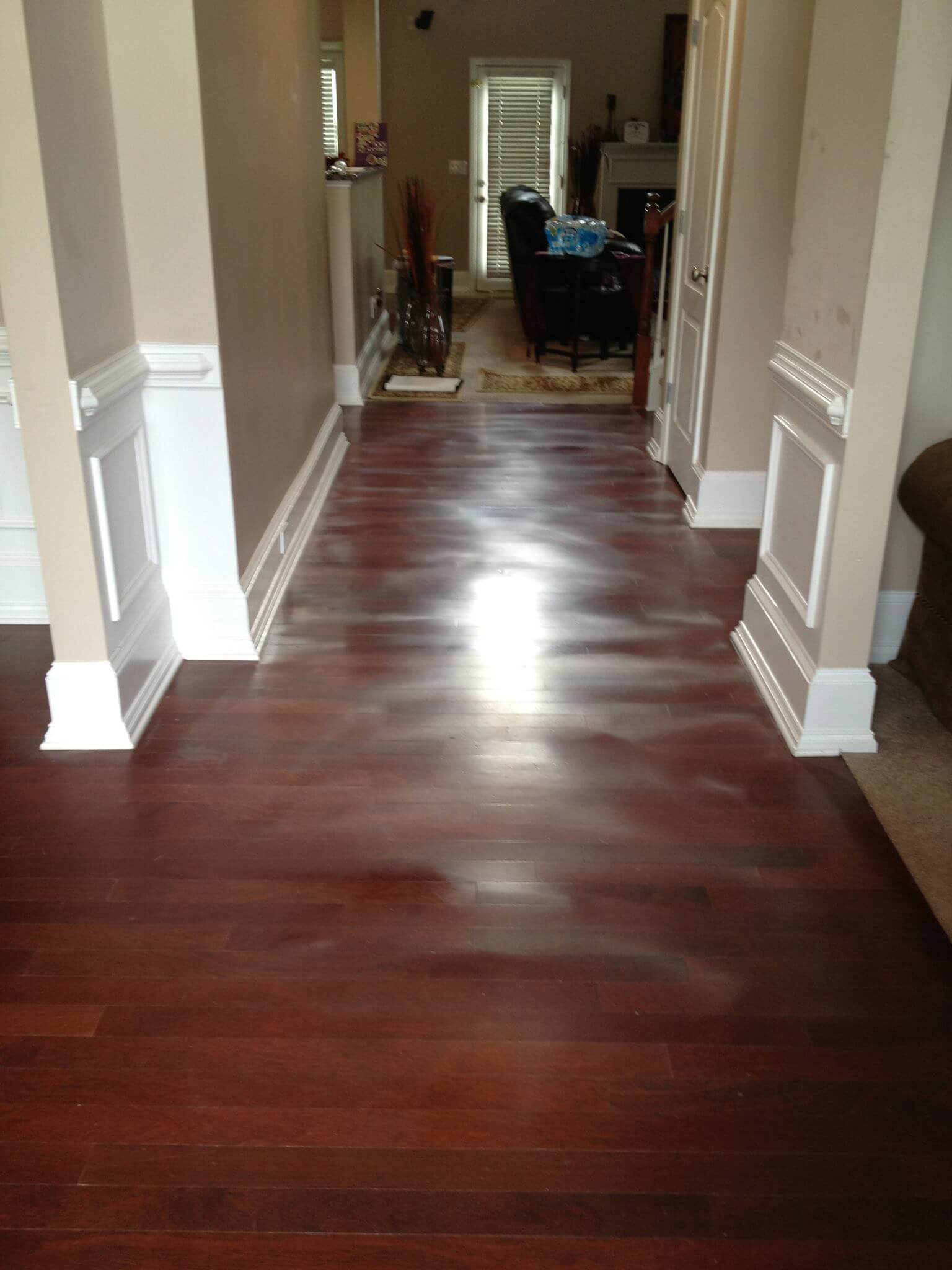 a warped hardwood floor showing serious signs of damage