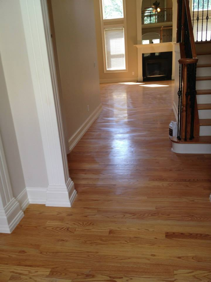 a before shot of one of our hardwood floor resurfacing projects